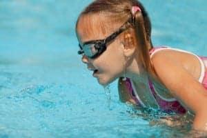 girl swimming at Gatlinburg vacation rentals with pools