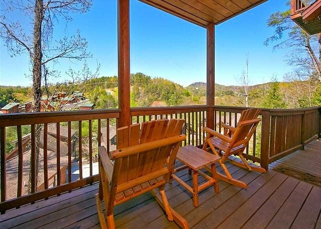Two rocking chairs on the deck of a Pigeon Forge cabin rental