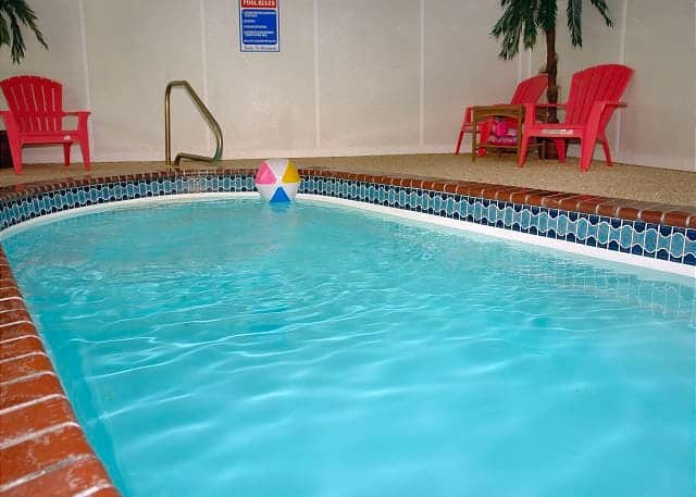 Indoor private swimming pool at a rental cabin in Pigeon Forge, Tn