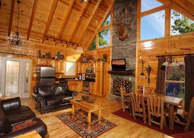 Open living area with stone fireplace in a Smoky Mountain cabin for rent