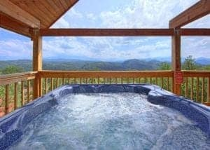 Hot tub on the deck of a cabin with mountain view near Pigeon Forge, Tennessee