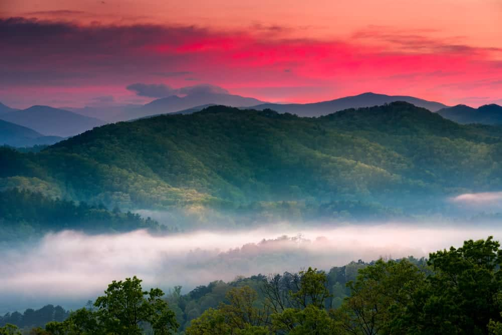 Sunrise over the Great Smoky Mountains with a layer of mist