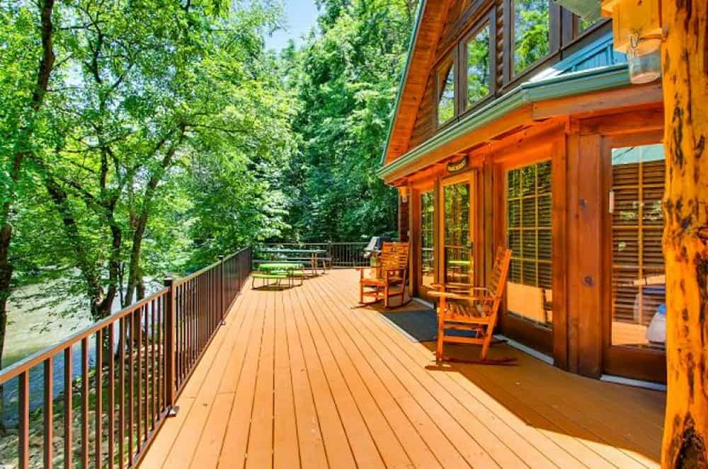 a river adventure cabin in pigeon forge with a river out front